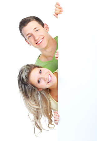 excited people: Young happy couple holding a white plackard
