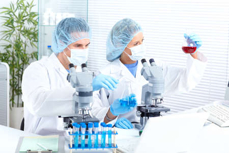 Science team working with microscopes at  laboratory Stock Photo - 8863752
