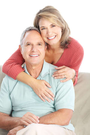 older couples: Happy seniors couple in love. Healthy teeth. Isolated over white background  Stock Photo