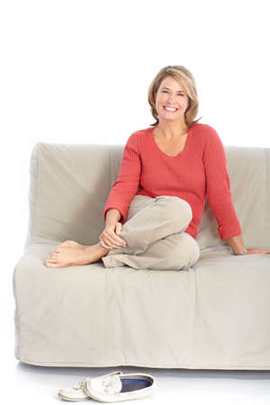 couches: Smiling happy  woman. Isolated over white background