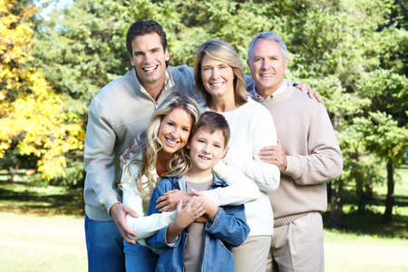 Happy family in park. Grandfather, grandmother, father, mother and son Stock Photo - 8863847