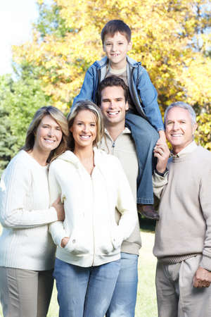 Happy family in park. Grandfather, grandmother, father, mother and son Stock Photo - 8863846