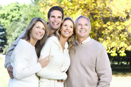 Happy family in park. Father, mother, son and daughter Stock Photo - 8863850