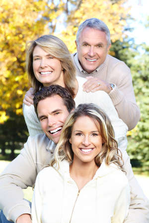 Happy family in park. Father, mother, son and daughter Stock Photo - 8863818