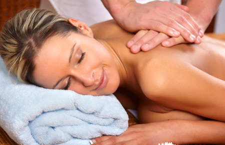holistic: Beautiful young woman getting a massage