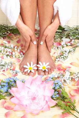 Female feet massage and flowers Stock Photo - 8863805