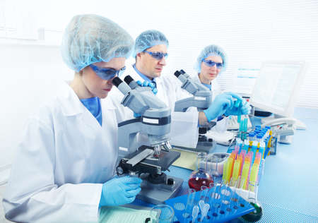chemical laboratory: Science team working with microscopes at  laboratory  Stock Photo