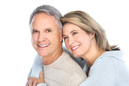 Par de edad feliz en el amor. Dientes sanos. Aislados sobre fondo blanco Foto de archivo - 8863750