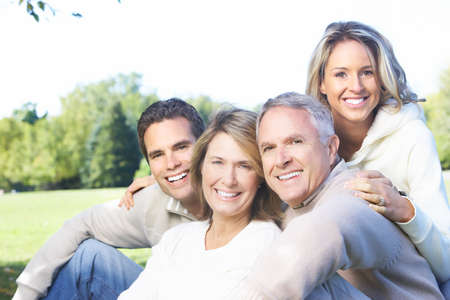 Happy family in park. Father, mother, son and daughter Stock Photo - 8863745