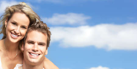 Young love couple smiling under blue sky Stock Photo - 8863673