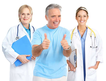 Smiling medical doctors and a smiling elderly man