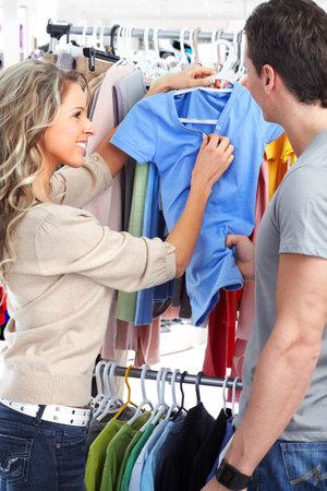 Shopping  smile couple. Isolated over white background  photo