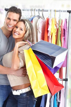 Shopping  smile couple. Isolated over white background Stock Photo - 8868264