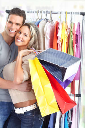 Shopping  smile couple. Isolated over white background  photo