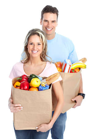 Happy young couple carrying shopping bags with food Stock Photo - 8868183