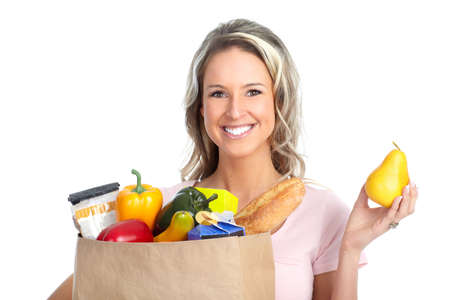 smiling young woman holding a shopping bag with food  photo