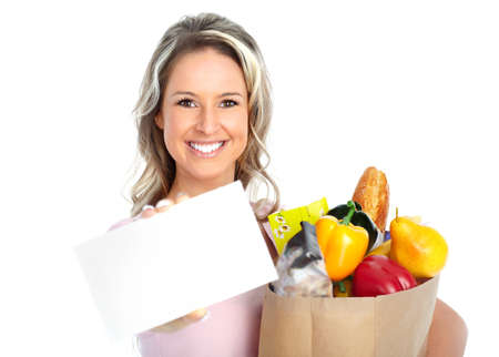 grocery stores: smiling young woman holding a shopping bag with food  Stock Photo