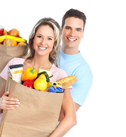 Happy young couple carrying shopping bags with food Stock Photo - 8868222