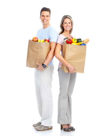 Happy young couple carrying shopping bags with food Stock Photo - 8868953