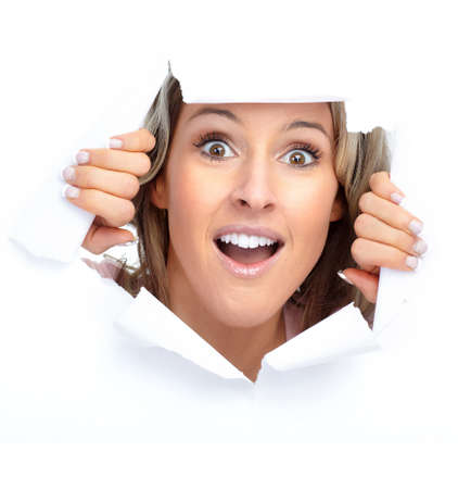 the hole: Cute young woman smiling looking through a hole   Stock Photo