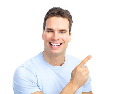 Handsome young man pointing. Isolated over white background  photo