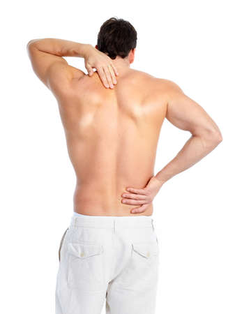 Sick young man. Back pain. Over white background  photo