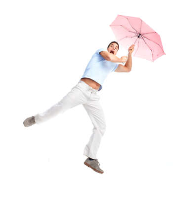 Young happy man with umbrella flying. Isolated over white background  photo
