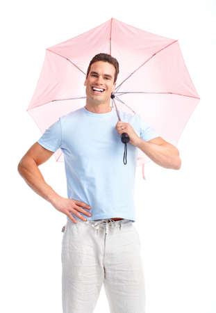 Young happy man with umbrella. Isolated over white background  photo