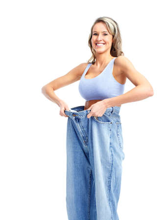 undressed: getting slim. Woman with big jeans