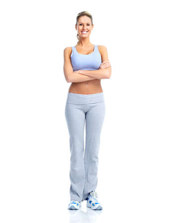 Fitness and gym. Smiling young  woman. Isolated over white background  Stock Photo