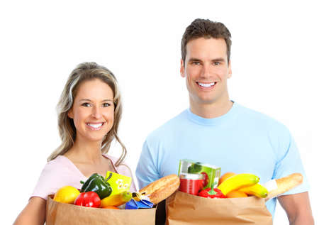 Happy young couple carrying shopping bags with food Stock Photo - 8868095