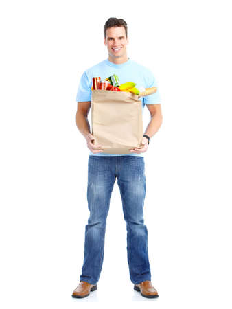 smiling young man holding a shopping bag with food photo