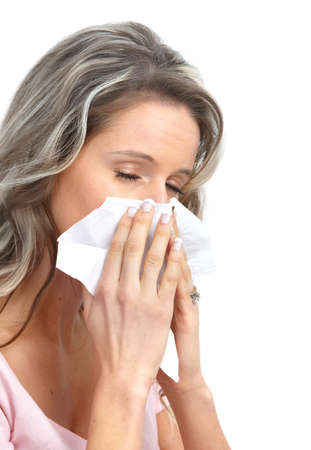 Young woman having flu or allergy. Isolated over white background  photo