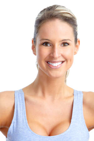 Fitness and gym. Smiling young  woman. Isolated over white background  photo
