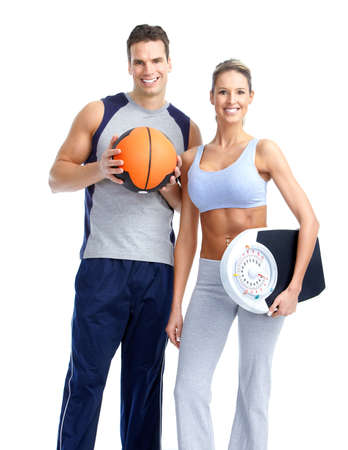 Healthy fitness people with a weight scale. Isolated over white background  Imagens