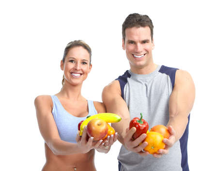 vegetables young couple: Young people with vegetables and fruits. Over white background  Stock Photo