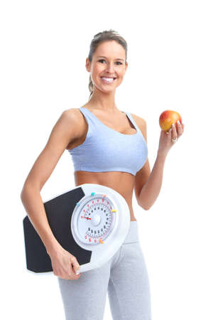 over weight: Healthy young woman with a weight scale. Isolated over white background