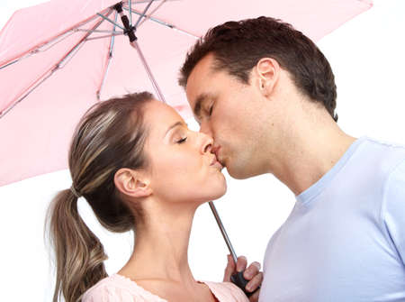 kissing mouth: Happy smiling couple under a pink umbrella   Stock Photo