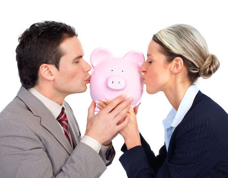 Business people holding a piggy bank. Isolated over white background  photo