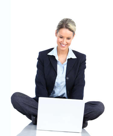 Young smiling  business woman working with laptop  photo