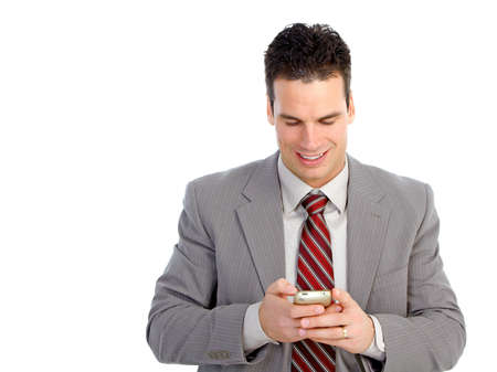Young  smiling businessman with a cellular. Isolated over white background  photo