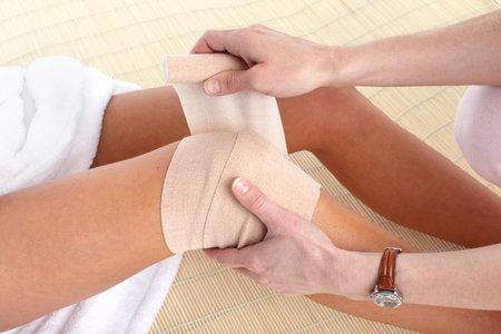 white bandage: Knee joint  pain. Bandage   Stock Photo