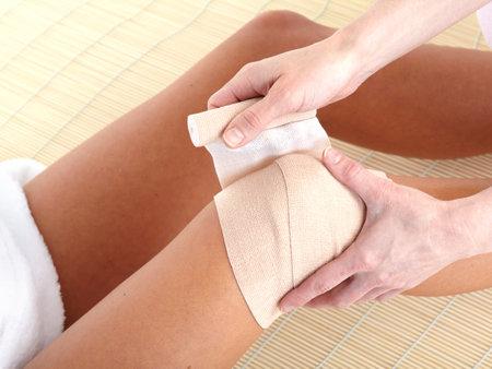 Knee joint  pain. Bandage   photo
