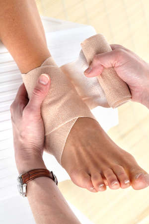 foot doctor: Foot joint pain. Bandage
