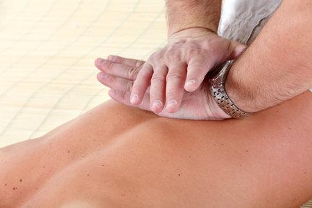 Massage of male back Stock Photo - 8868250