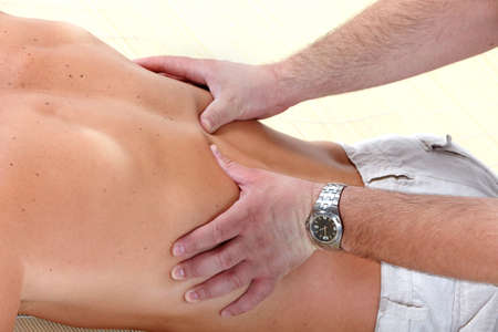 body parts: Massage of male back