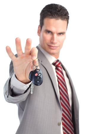 businessman holding car key. Isolated over white background  photo