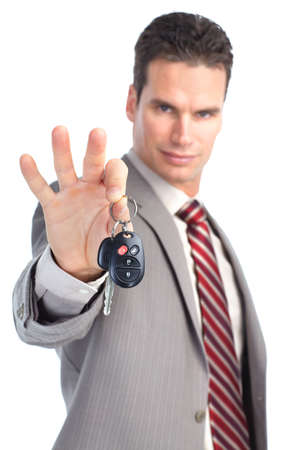 sales person: businessman holding car key. Isolated over white background  Stock Photo