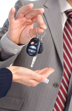 A businessman passing a car key  photo