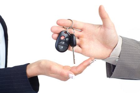 A businessman passing a car key
